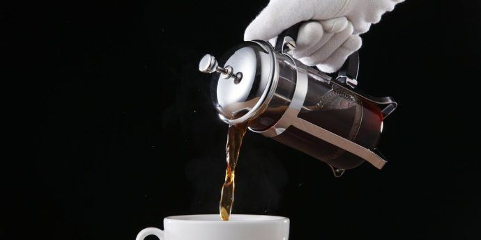Pouring coffee into a french press