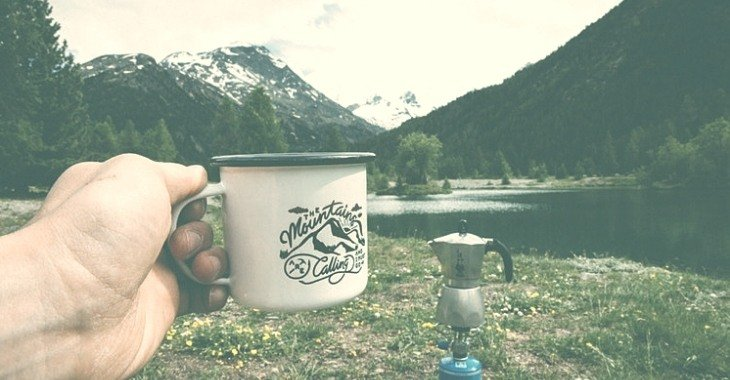a cup of coffee made while camping in the mountains