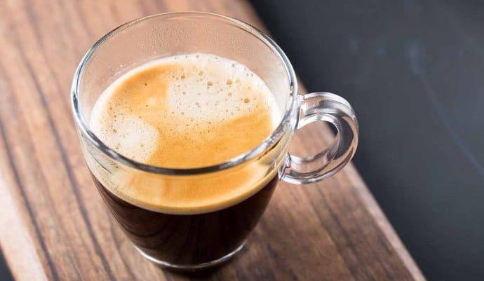 An americano coffee in a glass mug