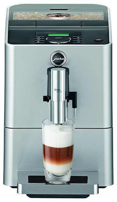 Silver Jura ENA Micro 90 Coffee Machine with freshly brewed coffee in a glass