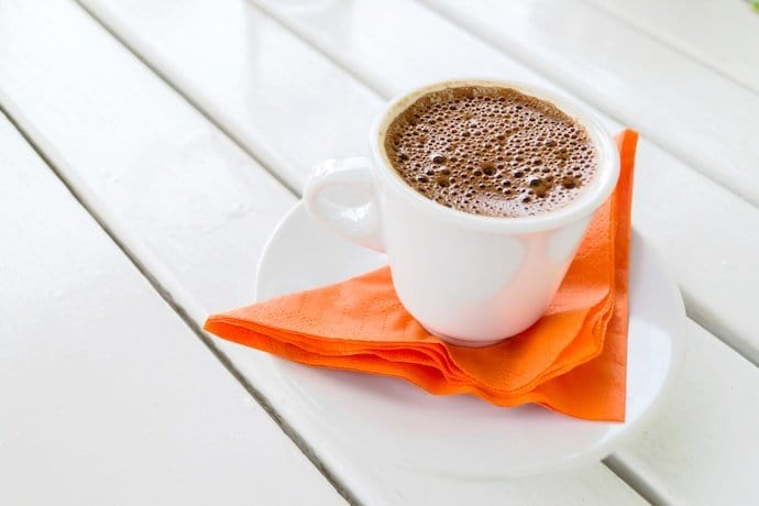 a cup of brown coffee