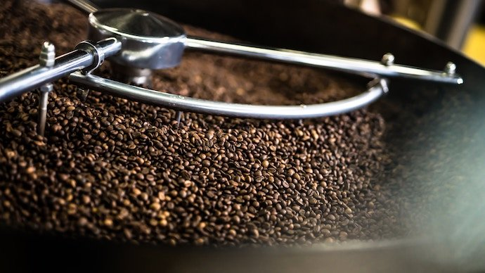 coffee beans stirred in a coffee machine