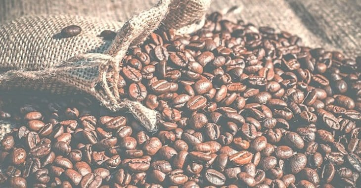 coffee beans spilling from the sack