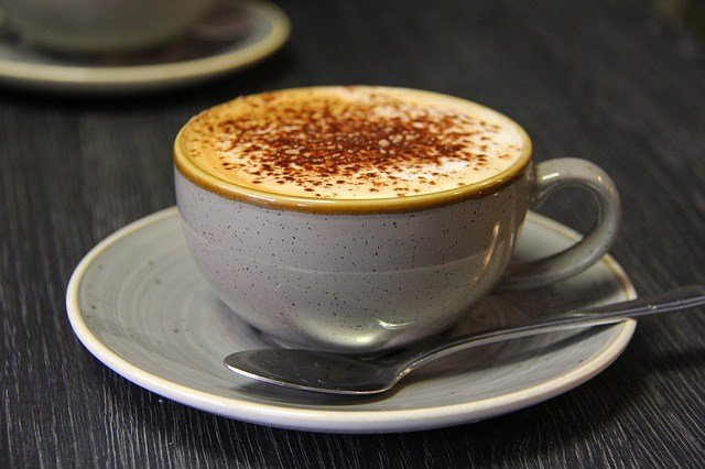 a silver cup of latte