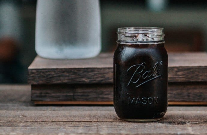 a jar of black coffee