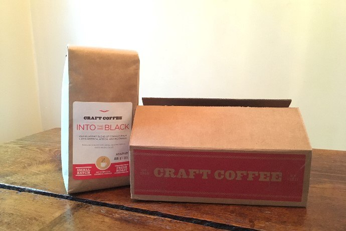 An open box of craft coffee beans
