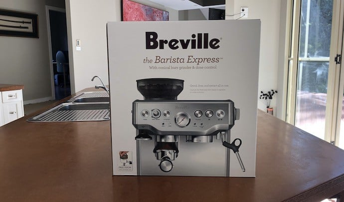 Breville barista express in box on kitchen counter