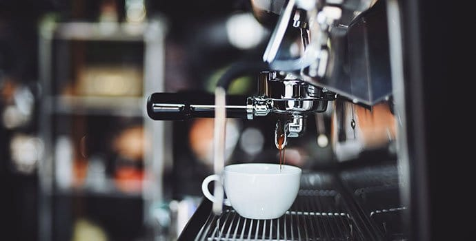 espresso dripping from the portafilter