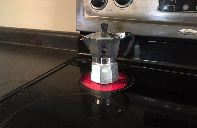 a photo showing how to use a stovetop espresso maker