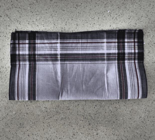 First fold, kerchief in half