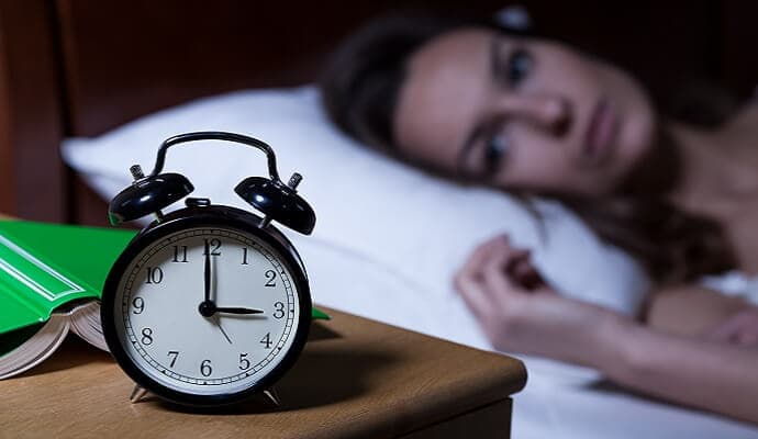 Woman have difficulty in sleeping at night assuming she had coffee before bed