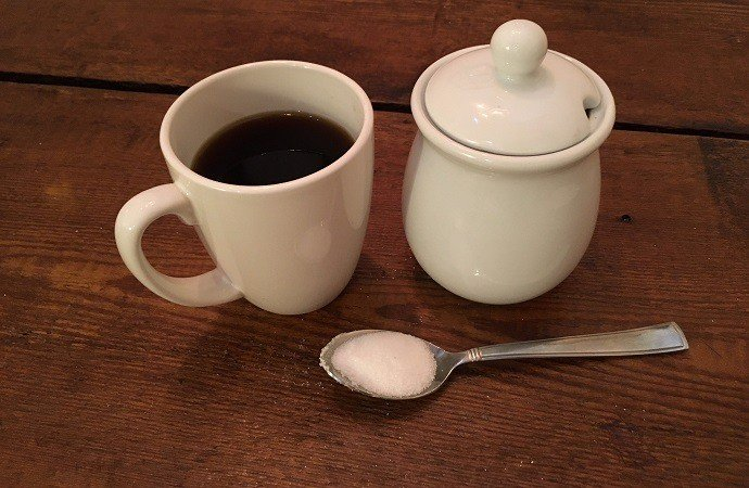 Black coffee plus sugar spoon