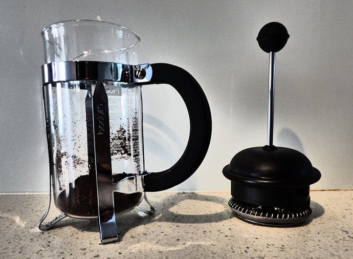 French press with coffee grounds