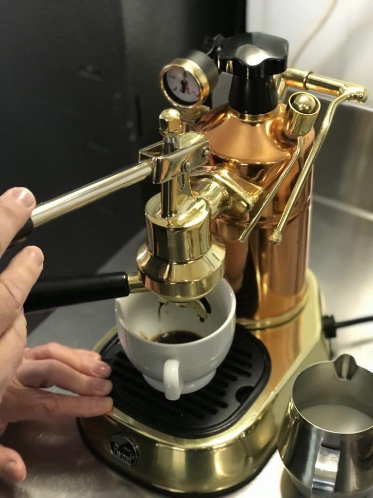 lever espresso machine pulling a shot