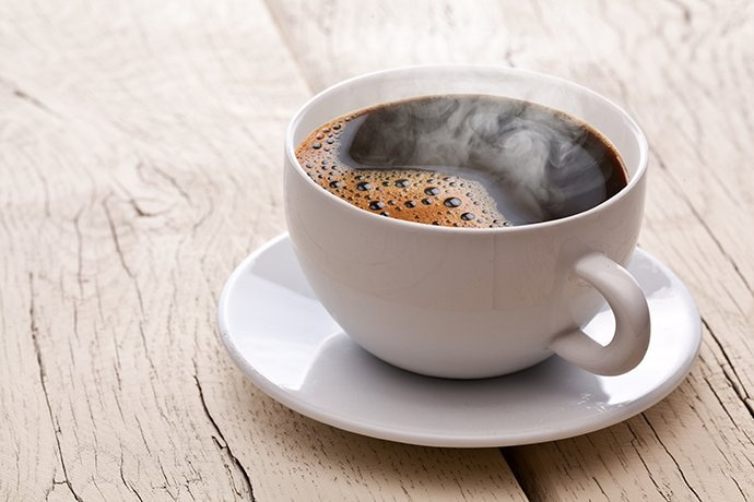 A hot coffee steaming