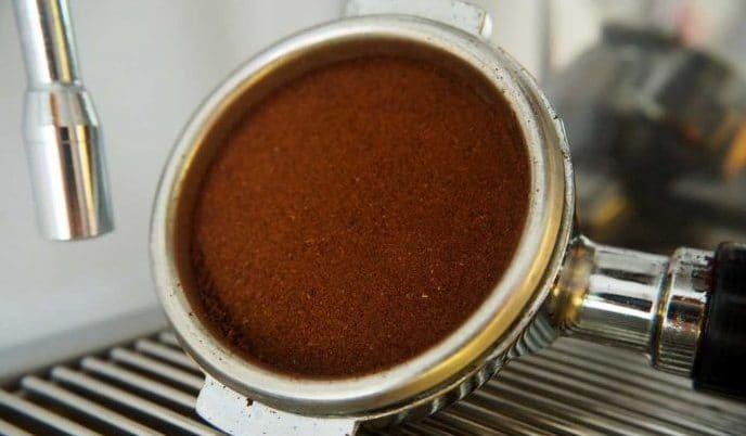 ground espresso beans tamped