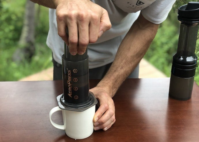 brewing aeropress coffee while pushing