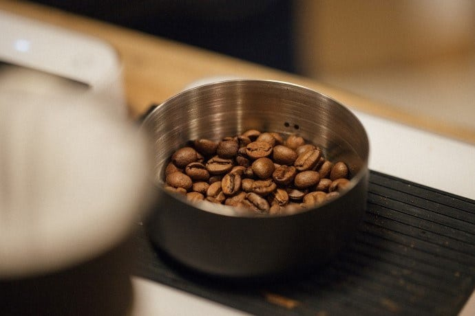 roasted coffee in a stainless steel container