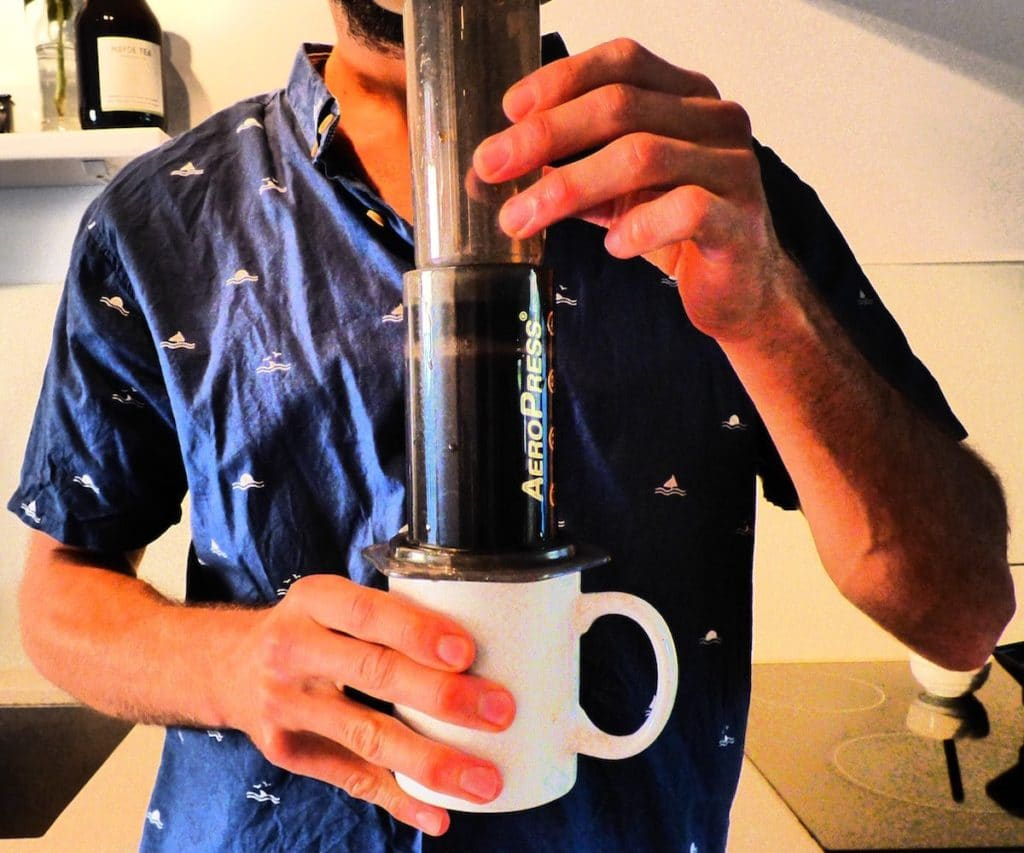 Slowly pressing the plunger of aeropress