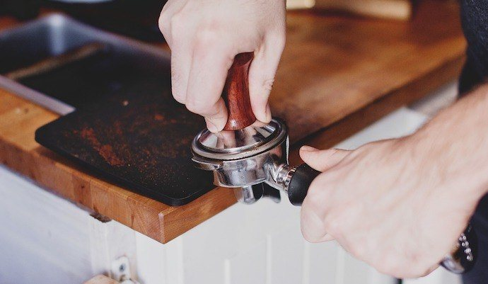 tamping coffee grounds for espresso shot