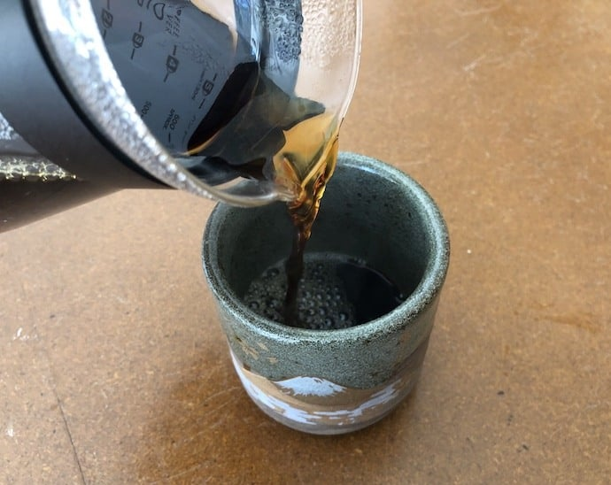 Pouring the v60 coffee into mug