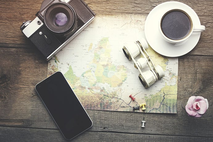 fresh coffee and travel accessories