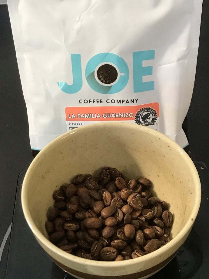 a packet of joe coffee and beans in a bowl
