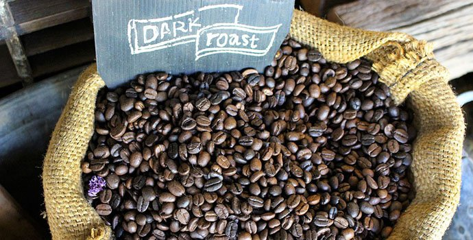 a sack of dark roast coffee beans
