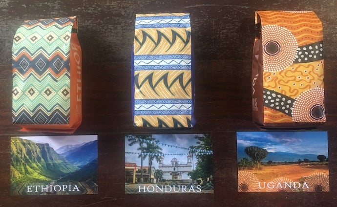 coffee knowledge - three bags of coffee beans from ethiopia, honduras, and uganda