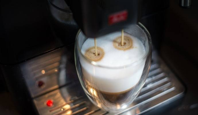 A coffee being pulled by an super automatic espresso machine