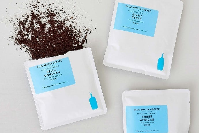 a flatlay photo of three blue bottle perfectly ground coffee sachets