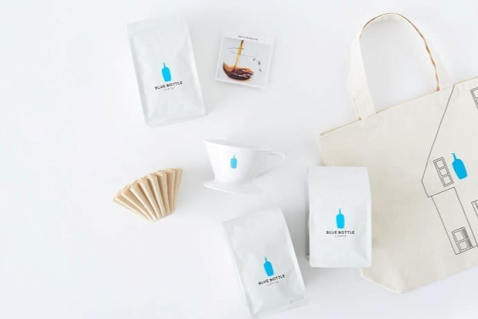 a flatlay photo of blue bottle products