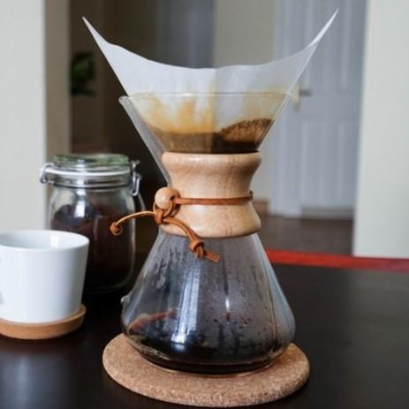 drip coffee being made with the Chemex and a paper filter on the table