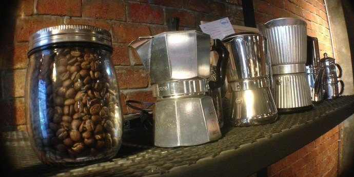 Best stovetop espresso makers or moka pots on a shelf, next to a jar of coffee beans