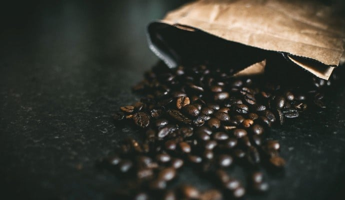 Black coffee beans degassing on the table