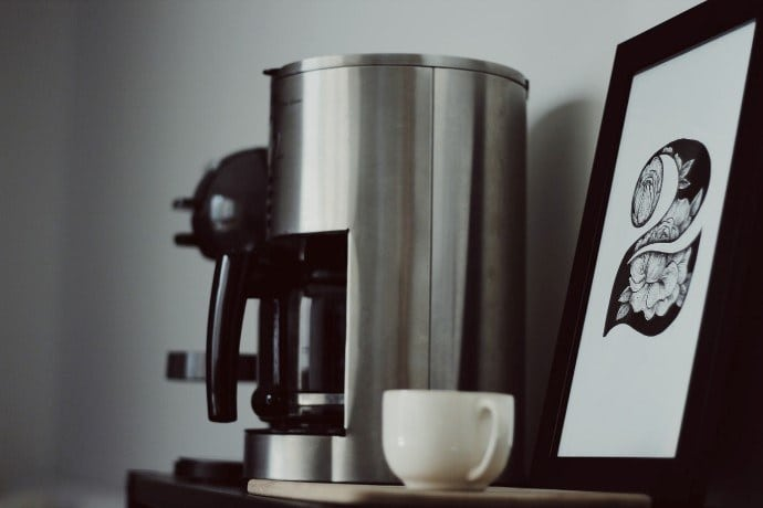 coffee drip machine and a cup