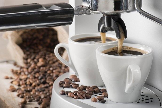 Double shot espresso pouring from portafilter