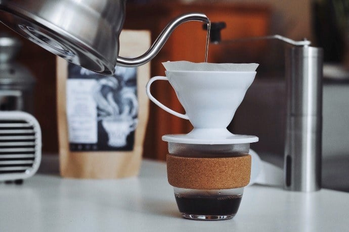 Gooseneck kettle brewing in Hario V60 ceramic cone