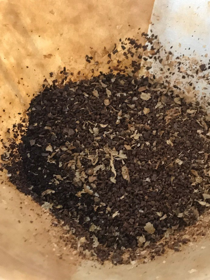 medium coarse coffee grounds on paper filter