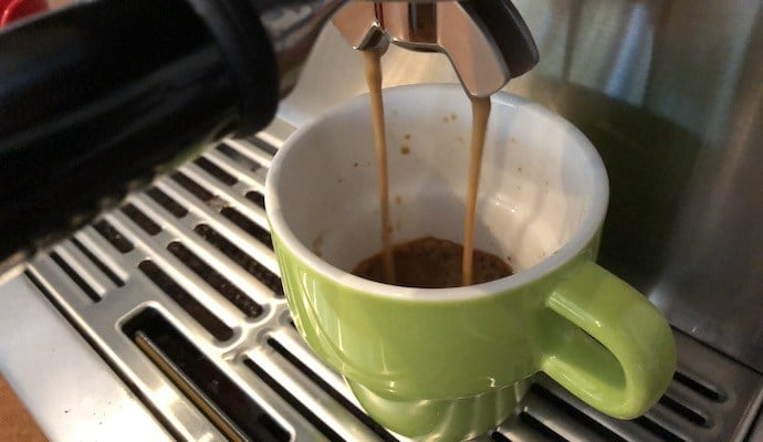 an image showing how to use an espresso machine to pull a shot