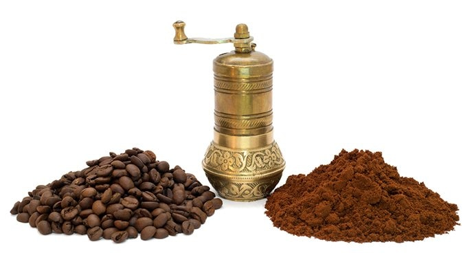 Turkish coffee grinder with beans and grounds