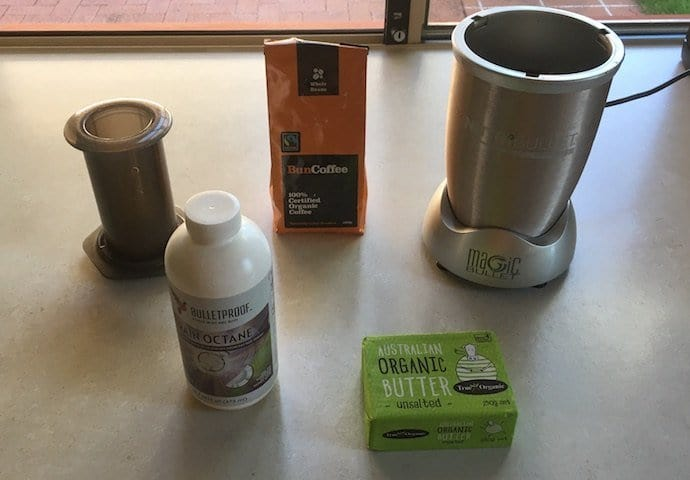 an aeropress, Brain Octane MCT oil. coffee, and butter