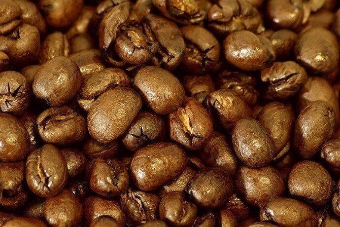 a close up photo of peaberry coffee beans