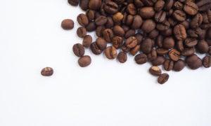 kona coffee beans on white paper