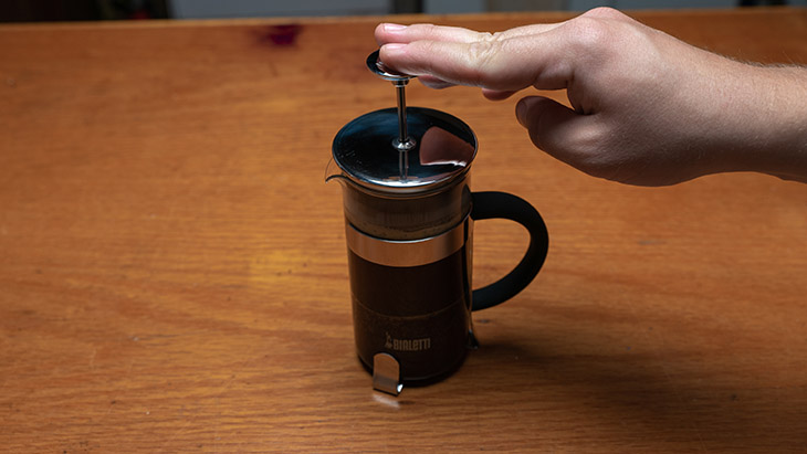 plunging a french press coffee maker