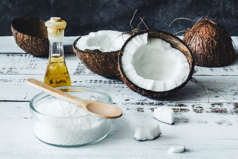 Coconut Oil with piece of Coconut