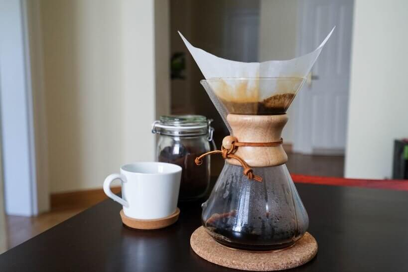 A chemex and a cup of coffee