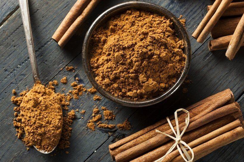 Cinnamon Sticks with bowl of powder