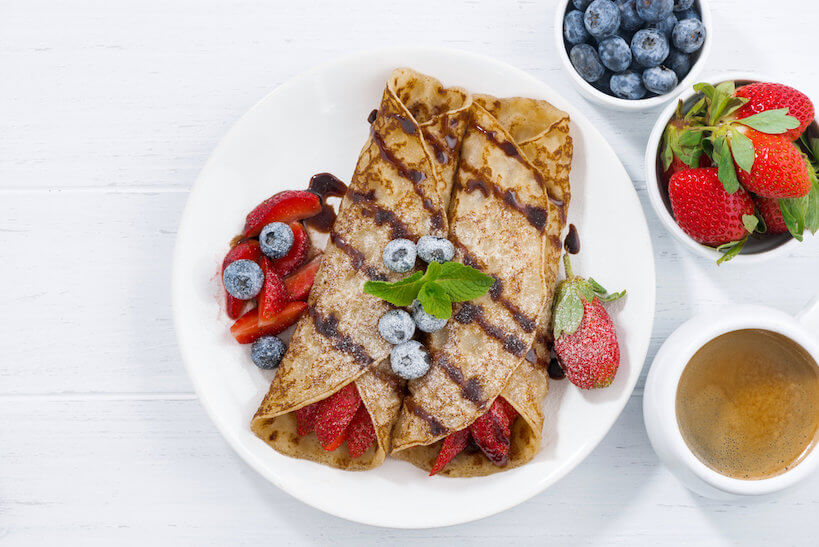 crepes with berries and chocolate sauce for breakfast