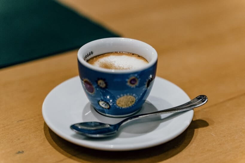 A cup of macchiato on a saucer